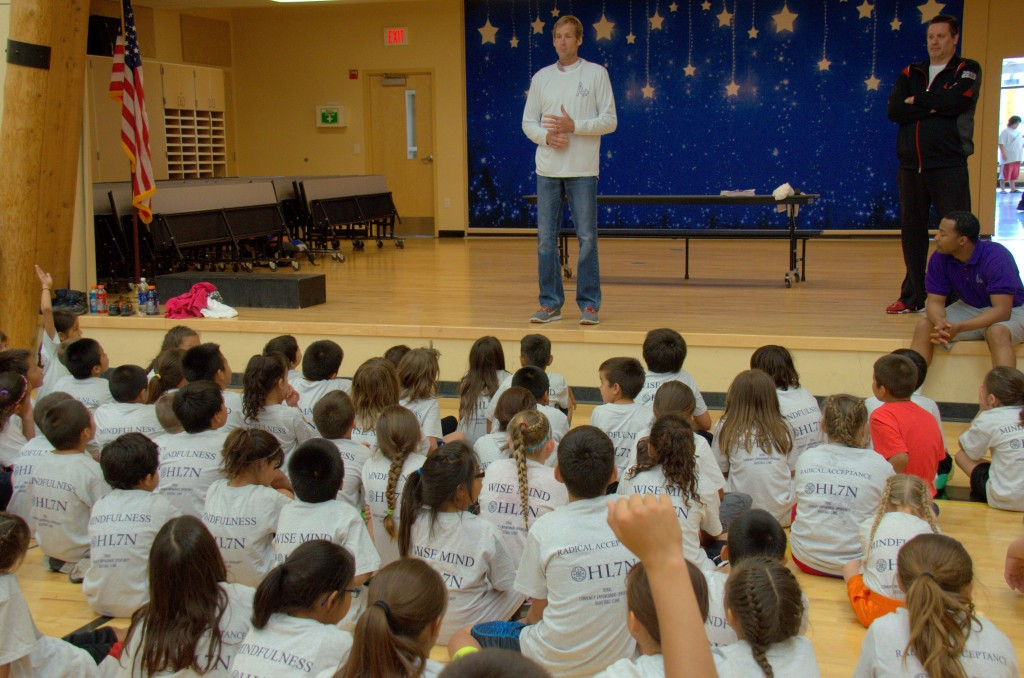 Kids listen attentively as former NBA player Craig Ehlo tells of his career. (Jack McNeel)